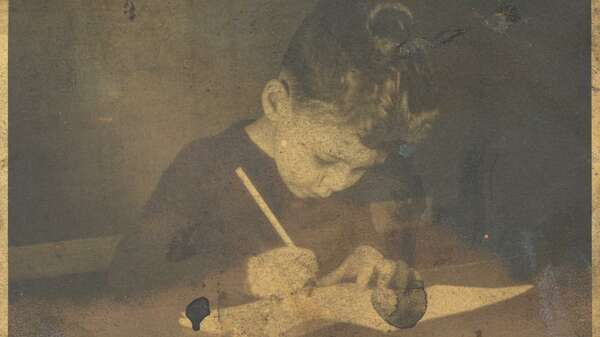 The great British painter Frank Auerbach as a child, drawing in his hometown Berlin., around 1935 Copyright Julia Auerbach
