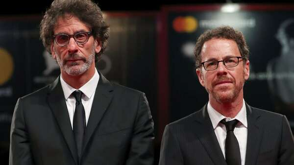 "The 75th Venice International Film Festival - ?Screening of the film ""The Ballad of Buster Scruggs"" competing in the Venezia 75 section - Red Carpet Arrivals - Venice, Italy, August 31, 2018 - Directors Ethan Coen and Joel Coen pose. REUTERS/Tony Gentile Foto: REUTERS"